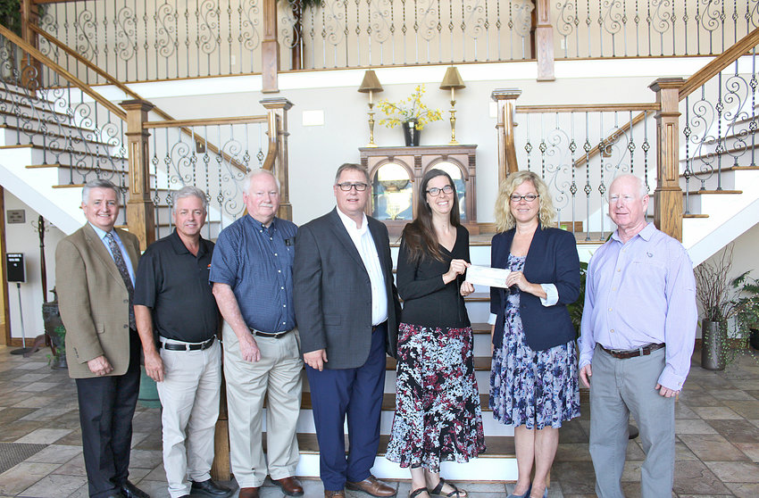 BEACON ACADEMY accepts a $10,000 donation from the Bachman Foundation during a presentation Tuesday. From left are board members Jimmy Dupree; Jeff Gregory; Ken Weller; director Mark Frizzell; Beacon Academy representatives Brigett Pangkey and Tiffany Britt; and board member Mike Sikes.