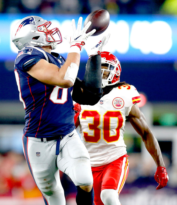NNEW ENGLAND PATRIOTS tight end Rob Gronkowski catches a pass in front of Kansas City Chiefs safety Josh Shaw in the second half Sunday, in Foxborough, Mass.