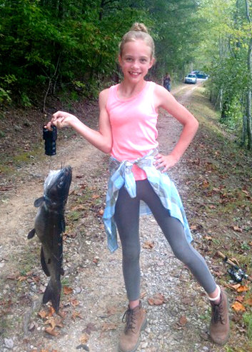 IT WAS a successful day for Emily Williams, who was all smiles after hauling in a 10-pound catfish on a recent trip with her father, Shaun Williams, and grandfather Mike Williams to Lake Agape in Polk County.