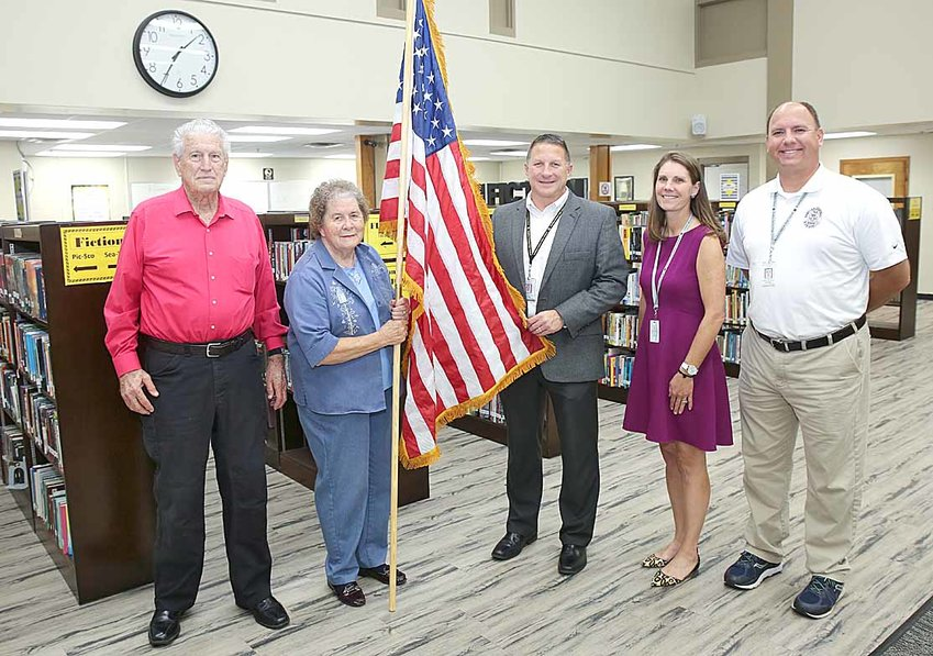 WOODMENLIFE REPRESENTATIVES, W.W. and Joyce Johnson, left, recently replaced a standing flag in history teacher Tamara Yelton's classroom.  From left are W.W. Johnson, Joyce Johnson, Principal Todd Shoemaker, Yelton and social studies teacher Andrew McMahan.