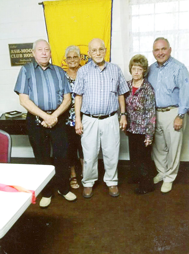 THE OAK GROVE RURITAN clubhouse was the site of a surprise birthday party for Ray Myers, a longtime member of the Ruritans. Several members of the community were on hand for the party. From left are Danny Trentham, Cherokee District Zone governor; Virginia Coleman, Oak Grove Ruritan Club president; Myers; Barbara Trentham, Oak Grove Club vice president; and Cleveland Mayor Kevin Brooks.