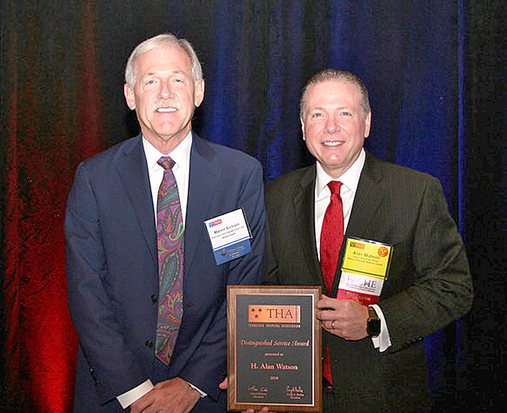CLEVELAND NATIVE Alan Watson, right, recently received the Distinguished Service Award from the Tennessee Hospital Association. Presenting the award was THA Board Chairman Marvin Eichorn.