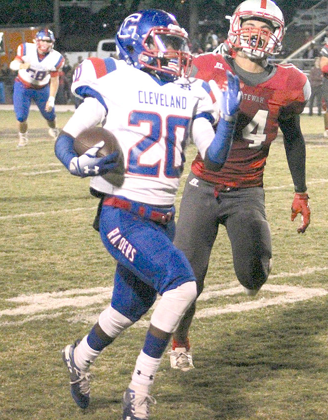 CLEVELAND RUNNING back Devarus Bowman takes off down the sideline as an Ooltewah defender gives chase. Bowman's 54-yard receiving score tied things at the end of the third quarter in an eventual 34-20 region loss to Ooltewah Friday night.