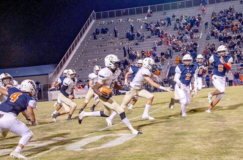BRADLEY CENTRAL sophomore Tray Curry (12) gets some great blocking and heads downfield on a Bear record-setting 98-yard kickoff return to open the second half of Friday night's 38-7 victory over William Blount in Maryville. The win secured the Bears' ninth straight TSSAA Playoff berth.