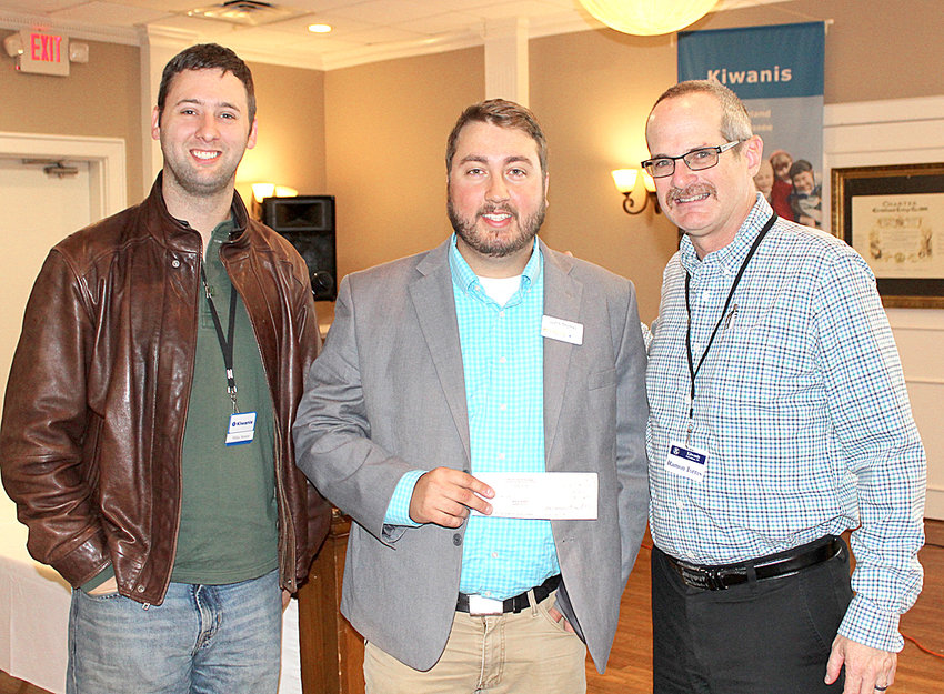 UT EXTENSION Agent Justice Thomas, center, receive a $100 donation from the Cleveland Kiwanis Club Thursday for assistance with this year's Life Maze, sponsored by the Bradley County Health Council. With Thomas is Kiwanis President Ramon Torres, right, and October Program Chairman Mike Stoess, left.