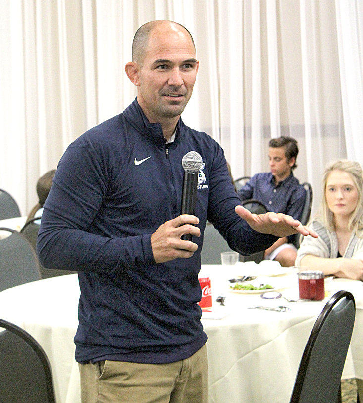 "HEATH ESLINGER, former UTC Mocs wrestling coach, says kids who received trophies will develop a ""false sense of accomplishment."" Eslinger made his comment during a luncheon held Tuesday by the Rotary Club of Cleveland at the Museum Center."