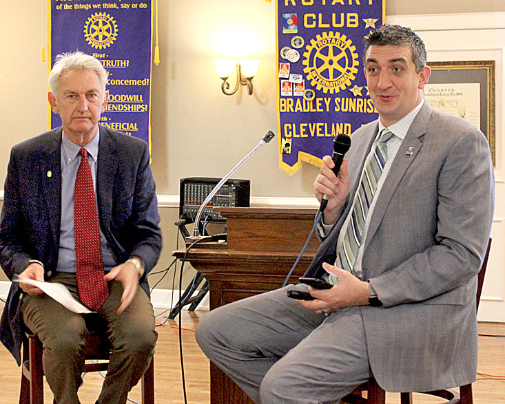 MICHAEL STONE of the Public Education Foundation of Chattanooga, right, speaks to the Bradley Sunrise Rotary Club. Joining him is club President Rick Creasy.