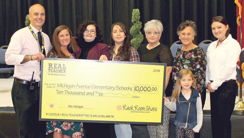 MICHIGAN AVENUE ELEMENTARY just received a $10,000 grant from Rack Room Shoes. From left are Principal Robbie Winters, teacher Jessica Morgan and staff of Rack Room Shoes. Joining them are April Whiddon, far right, who nominated Morgan for Rack Room Shoes' Real Teacher of the Year Contest, and her daughter, Allie Lamb.