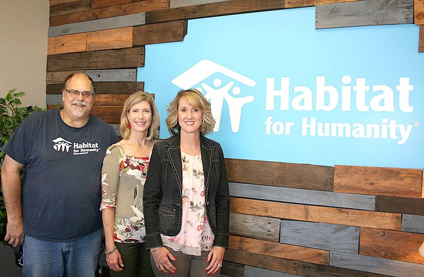 THE STAFF of Habitat for Humanity of Cleveland stand in front of their newly redesigned entrance wall, which was designed using recycled pallet planks. From left are Dave Williams, ReStore manager; Meta McGuire, community engagement manager; and Tammy Johnson, executive director.
