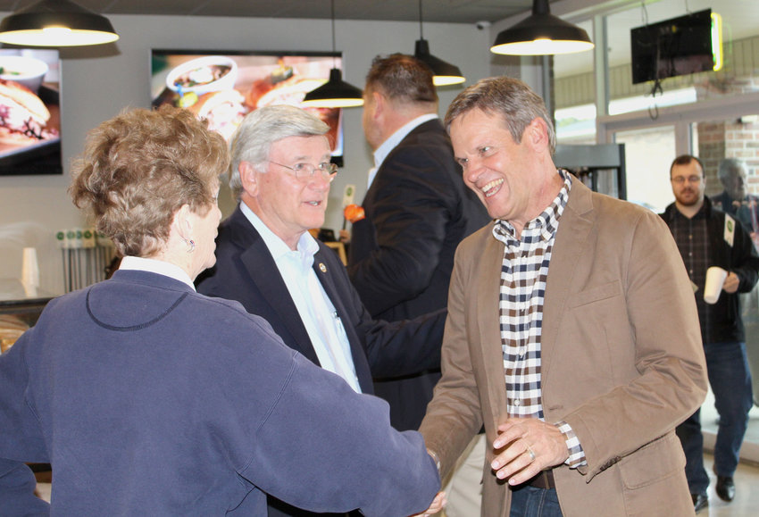 GUBERNATORIAL CANDIDATE Bill Lee, left, shakes hands with Peggy Meyers as he enters Deli Boys restaurant Monday during a campaign stop in Cleveland. Also pictured is Tennessee State Sen. Todd Gardenhire.