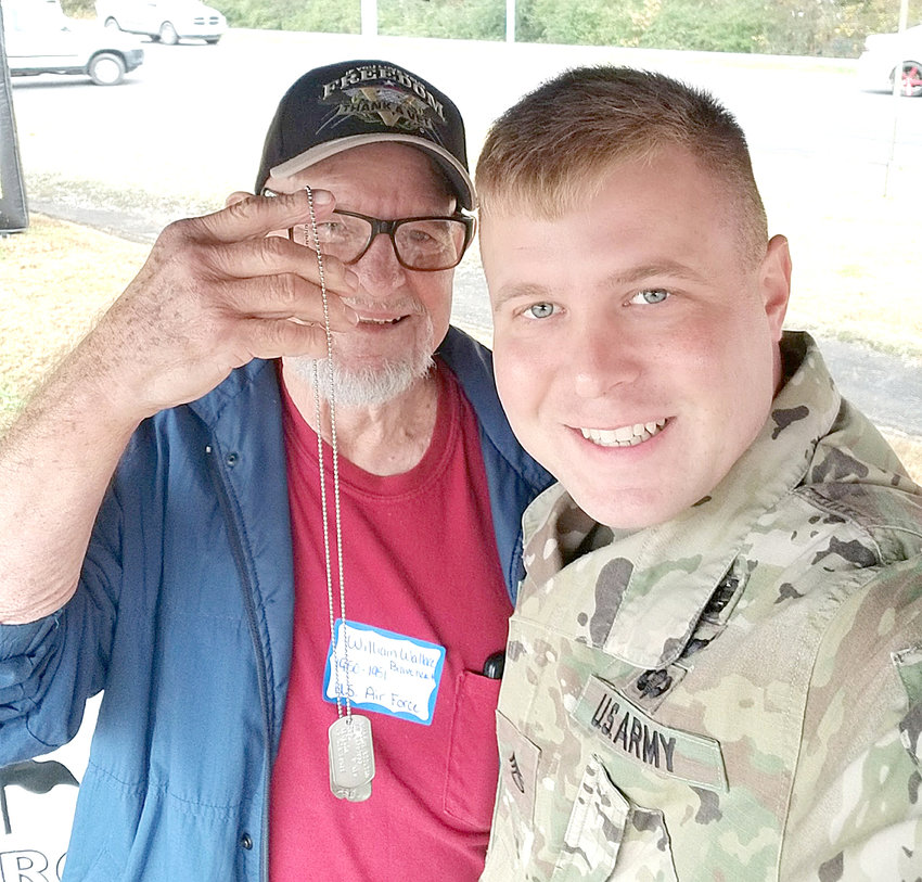 LOCAL VETERAN William Wallace, left, who served in the U.S. Air Force from 1950 to 1951, displays a new set of dog tags he received from Sgt. Christopher Butt at last year's Veterans Appreciation Day at the Chick-fil-A Restaurant on Keith Street.