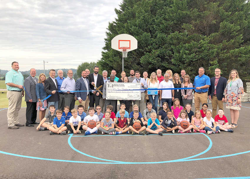 STUDENTS AND EDUCATORS joined several community leaders and supporters for the dedication of its outdoor basketball court. The creation of the new court was made possible with help from the Bradley County Youth Basketball All-Stars.
