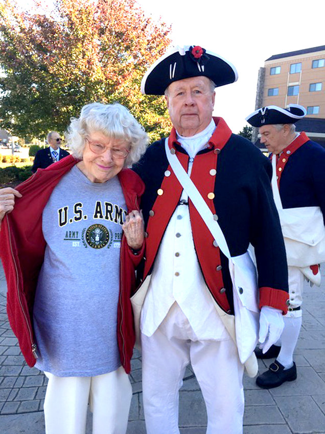 MEMBERS of the Col. Benjamin Cleveland Chapter, Tennessee Sons of the American Revolution, recently participated in an SAR Flag certificate presentation at Garden Plaza at Cleveland. Claude Hardison and U.S. Army nurse Gloria  Martin chat after the presentation.
