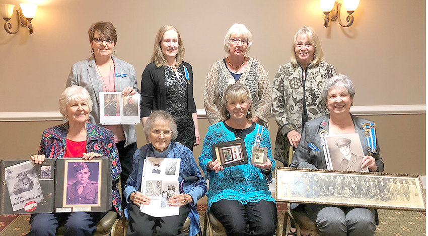 Ocoee Chapter DAR members with photos of family members who have served in the military.