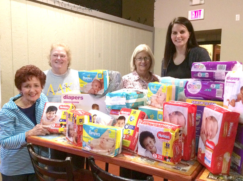 SISTERS of Alpha Theta Chapter of Alpha Delta Kappa, an international honorary sorority for women educators, donated a generous supply of diapers for their November altruistic project. This generous donation will be delivered to the New Hope Pregnancy Care Center by their altruistic chairman, Melinda Braunstein. From left are Phyllis Altopp, retired; Janet Blackwell, retired; Elaine Kirkpatrick, retired; and Ashley Douglas, Ocoee Middle School.