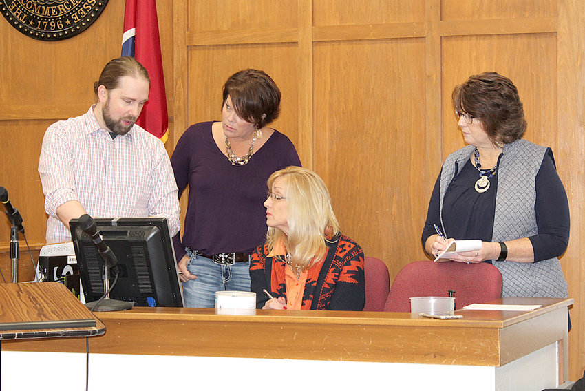 PRESTON WEST, CEO of Keystone Solutions, demonstrates the new courtroom technology in Judge Andrew Freiberg's courtroom at the Bradley County Judicial Complex. From left are West; Kimberly Moore, judicial assistant to Freiberg; Denise Barnes, court reporter for Freiberg; and Patricia Newman, judicial assistant to Judge Sandra Donaghy.