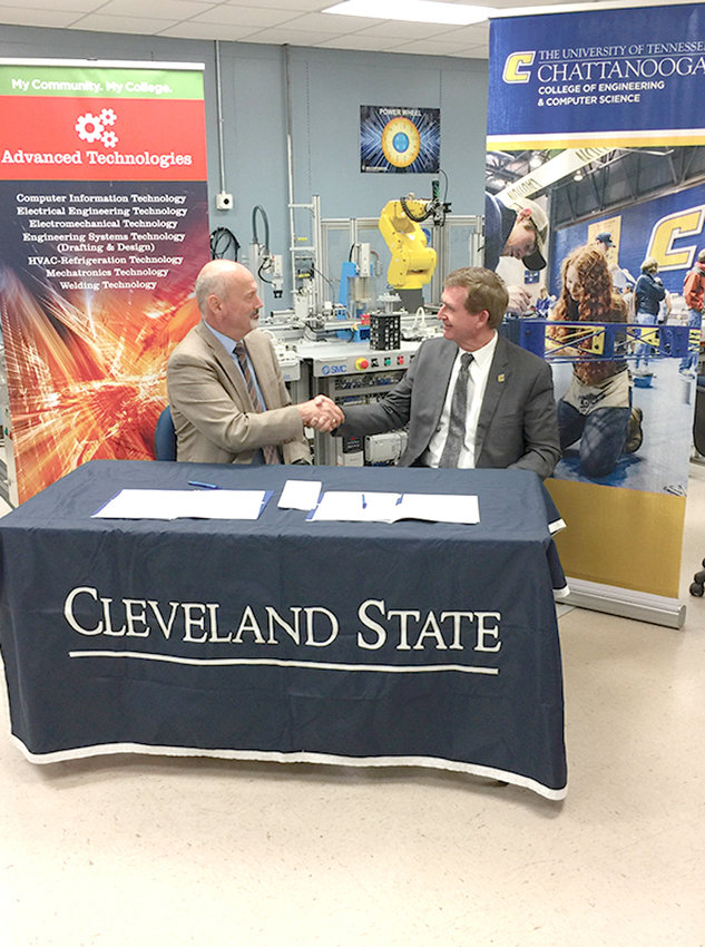Dr. Bill Seymour, CSCC president, and Dr. Steven Angle, UTC chancellor, signed an agreement on Monday that will allow for a smooth transition for students graduating from CSCC to transfer to UTC to study for their bachelor's degree.
