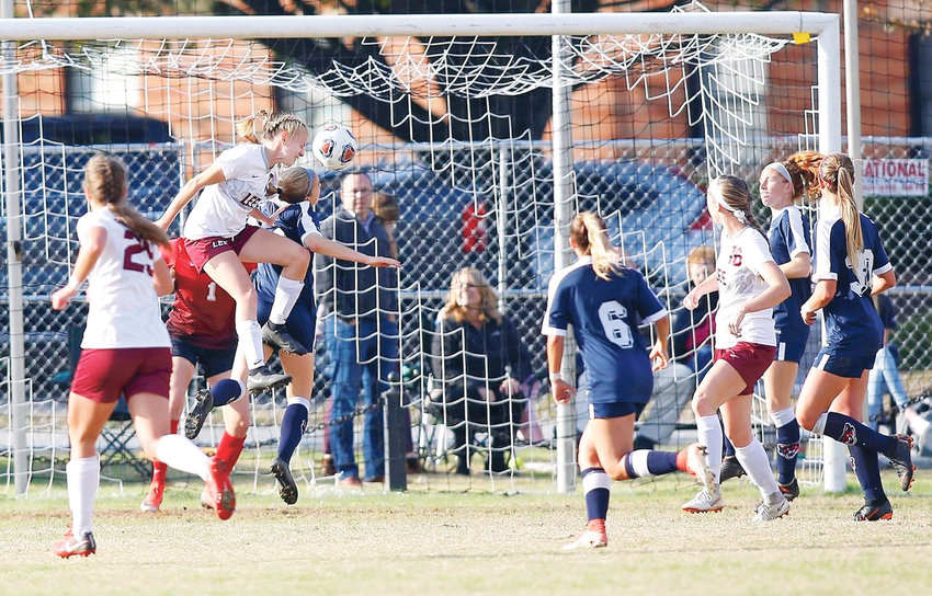 LEE UNIVERSITY freshman Lauren Weimer heads in the game-winning goal to advance the Lady Flames to their first NCAA Final Four with a 1-0 victory over previously unbeaten and No. 3 Columbus  (Ga.) State Sunday afternoon at the Lee Soccer Field.