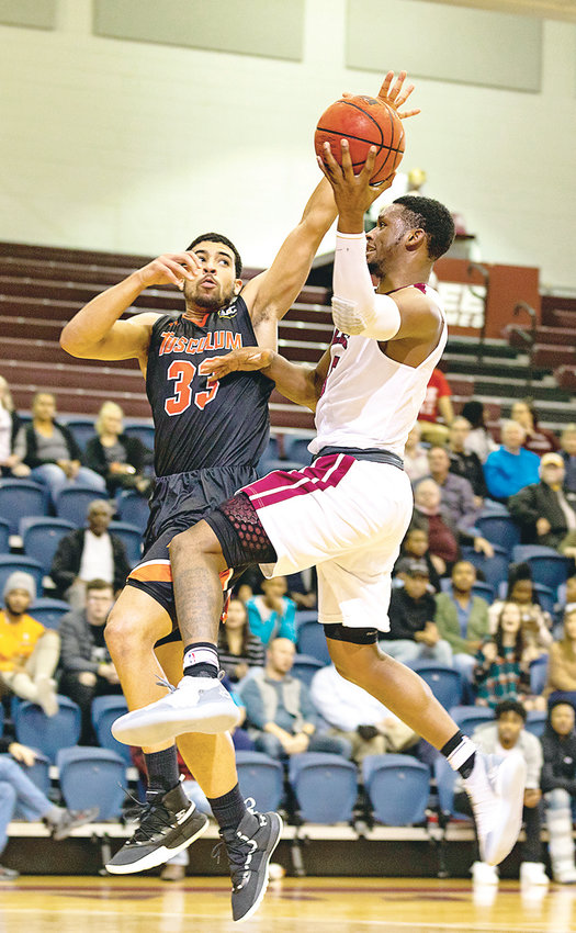 LEE UNIVERSITY junior Ryan Montgomery, right, led the Flames with 18 points Monday, but it wasn't enough as Tusculum University claimed a 79-56 victory at Walker Arena.