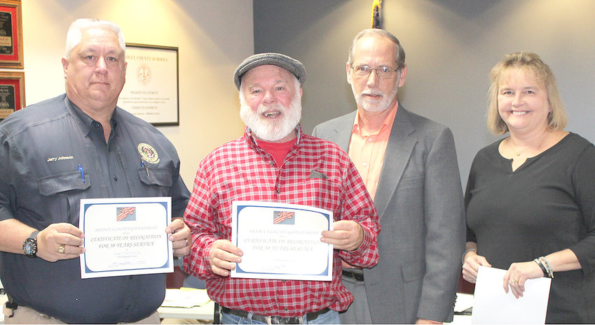 BRADLEY COUNTY Mayor D. Gary Davis presented 30-year service pins and certificates to, from left, Jerry Johnson, operations officer with the Bradley County Emergency Management Agency; Ronnie Keller with the Bradley County Road Department; Davis; and Bradley County Clerk Donna Simpson.