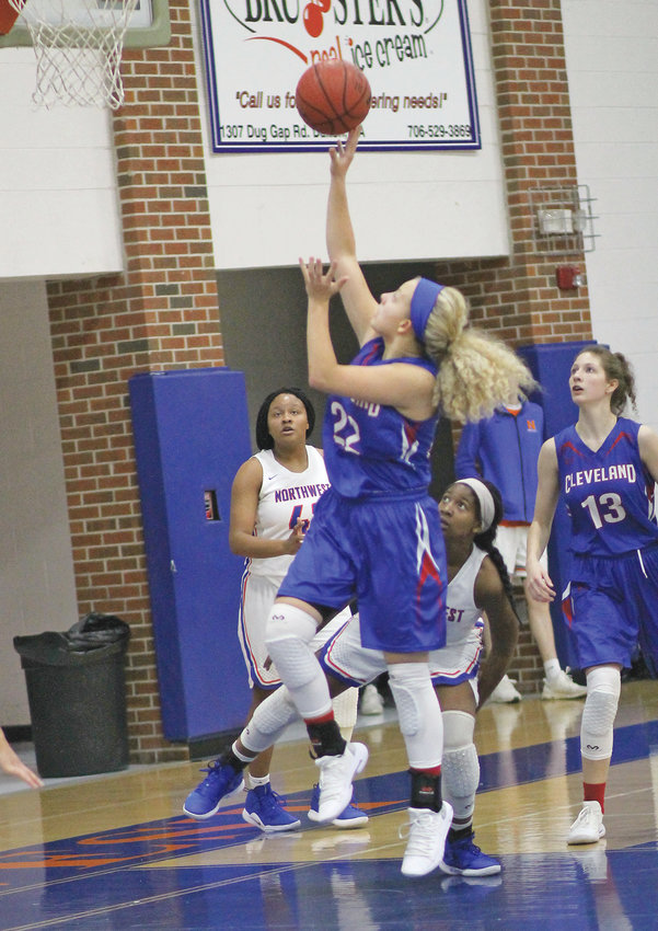 CLEVELAND HIGH sophomore Joy Douglass (22) goes up for two of her 13 points in Wednesday evening's championship game at the Border Wars Thanksgiving Tournament in Tunnel Hill, Ga.