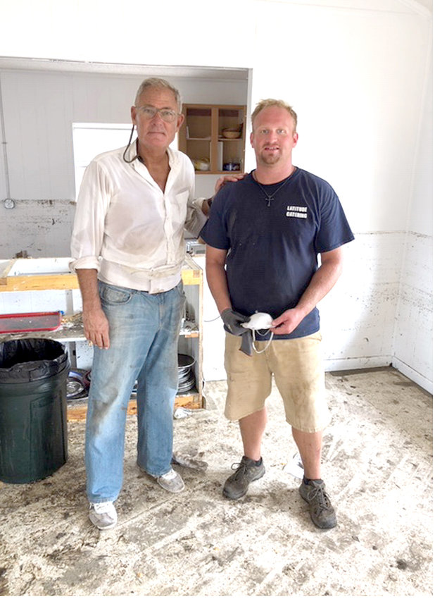 CHATTANOOGA attorney Russell King is pictured with Clevelander Andrew Walsh, who volunteered with a team from Arizona to repair the United Methodist Church of Mexico Beach. King and his nephew, Dr. Lebron Lackey, built the home that withstood Hurricane Michael. Their home has been useful in providing shelter for relief workers. King had high praise for Walsh and shared his thankfulness for him and other volunteers that are working to help the efforts in Mexico Beach.