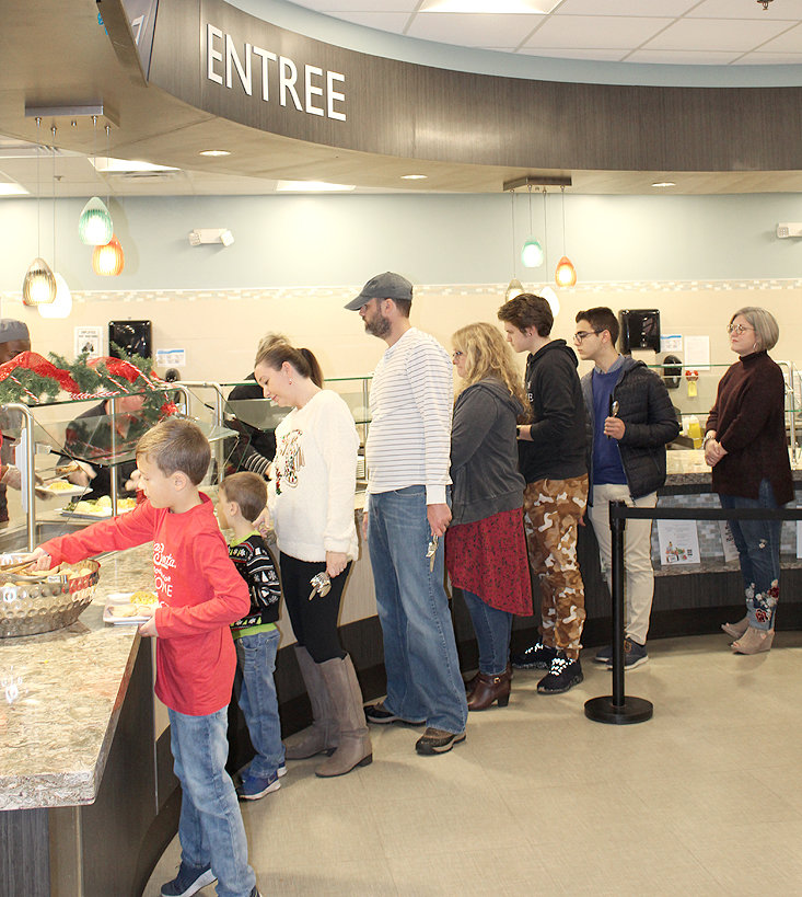 LEE UNIVERSITY students, alumni and faculty members wait in line as they are served a post-Thanksgiving luncheon held for students unable to return home for the holiday.