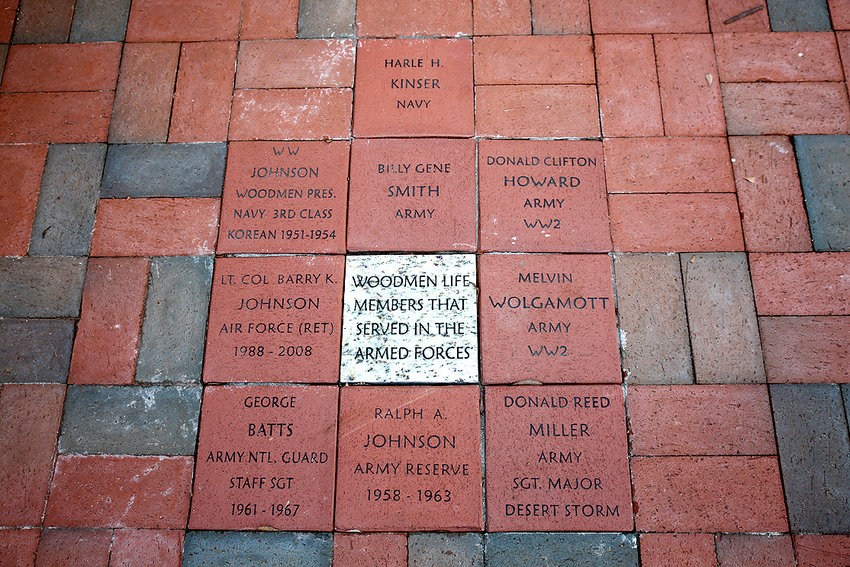 The Ocoee Middle School Freedom Circle Project began as a campus beautification project.  The Freedom Circle was created to honor veterans of the United States armed services.  Over the years, many people have purchased 8-by-8-inch engraved paving stones to honor a family member or friend who has bravely served our country.  The bricked Freedom Circle is surrounded by flags honoring each branch of the U.S. military, with the Stars and Stripes as the central focus.  The Woodmen of the World Lodge 16 purchased nine bricks honoring members of their organization.   Veterans Day is always the most popular time of year to purchase the pavers; however, you may stop by the Ocoee Middle School office any weekday to purchase a brick.