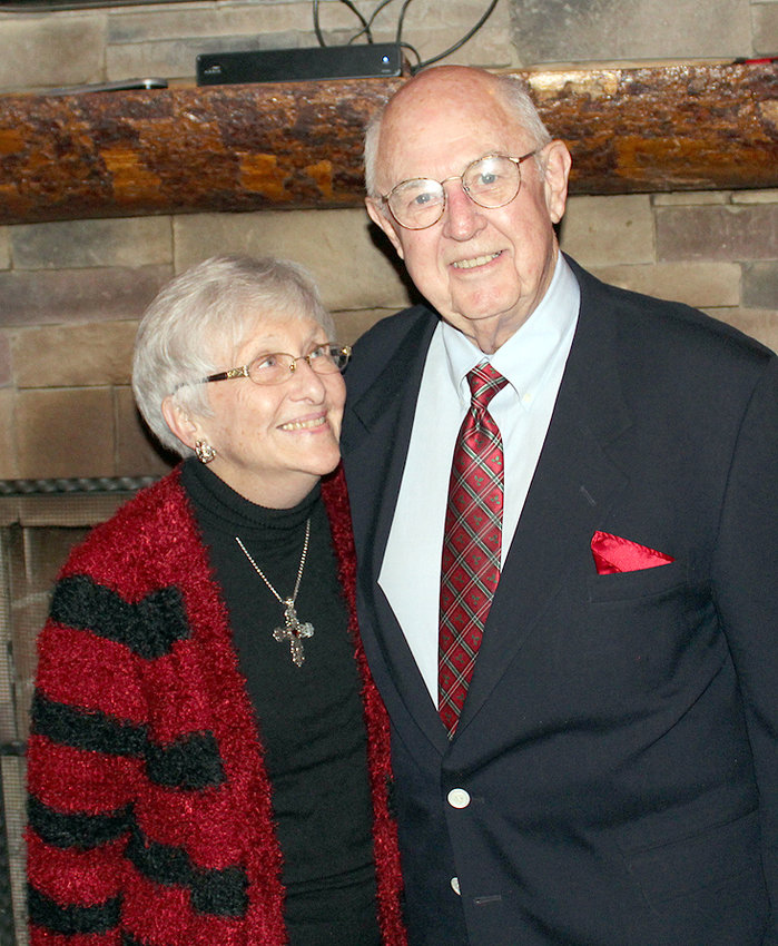 LONGTIME Life Bridges board member Eddie Cartwright, poses with his wife, Milteen Cartwright. He was  honored Friday for his contributions to the organization during a surprise dinner party held at the Bald Headed Bistro.
