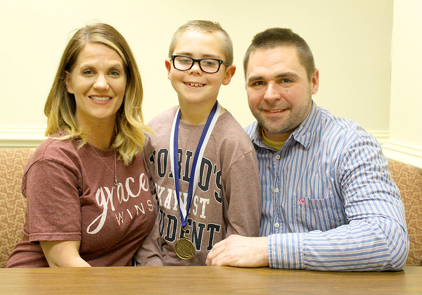 """LOCAL STUDENT Maclane """"Mac"""" Burrell has been sharing his family's story of hope after his parents, Julie and Will Burrell, overcame their addictions to prescription opioid drugs."""