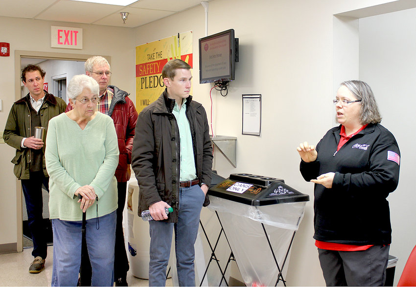 THE BRADLEY SUNRISE ROTARY CLUB recently donned their hairnets and went on a tour of Cleveland Coca-Cola Production Center led by Coca-Cola staffer Debbie Millard, kneeling second from right.