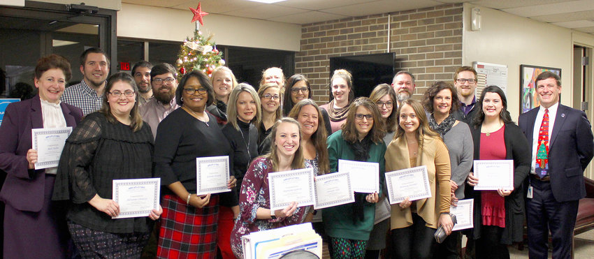 TWENTY-FOUR TEACHERS were granted tenure during Monday's Cleveland Board of Education meeting. Many of the honorees took a moment to celebrate with Director of Schools Dr. Russell Dyer, far right.