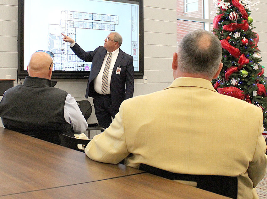 LAKE FOREST Middle School Principal Ritchie Stevenson points to the floor plan for the school as Bradley County Commission Chairman Johnny Mull, left, and Bradley County Trustee Mike Smith, right, look on. County officials toured the school on Thursday, and were treated to lunch.