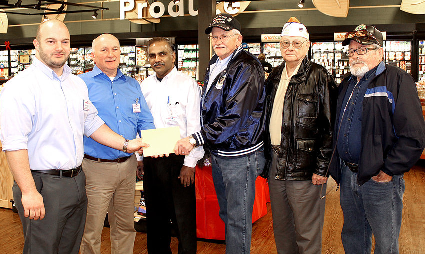 FOOD CITY is assisting a local veterans' organization, contributing $1,000 to the VFW Post 2598 Rebuilding Fund. The post's home on North Ocoee Street was destroyed by fire in September. Participating in the presentation at the North Food City on Thursday were, from left, north store manager Eric Hozouri, south store manager Mitch Cochran, north store assistant manager Dale Khan, VFW Quartermaster Ernie Griggs, VFW Post Surgeon Carl Zurcher and VFW Trustee Dederick Crisp.