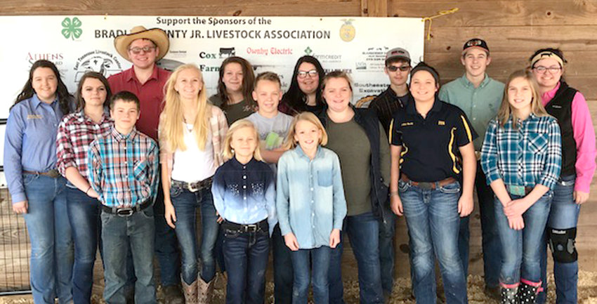 Participants in the 4-H and FFA market Hogs competition were, from left, front, Liara Pols and Alyssa Ownby; middle, Jonas Pols, HaLee Kazy, Jacob Fox, Haley Fox, Jolee Neely, and Olivia Congdon; and back,  Keri Beth Cox, Kanda Haney, Jakie Starnes, Adrianna Blackwell, Alex Blackwell, Cole Ledford, Dustin Barnett and Sydney Brady.