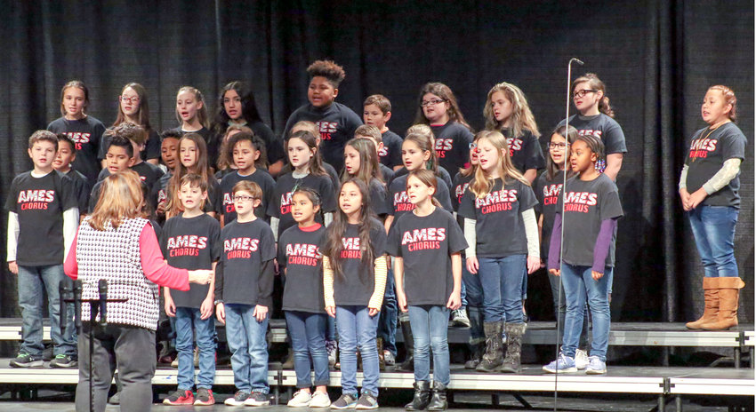 THE ARNOLD ELEMENTARY Choir sings during the Junior Achievement of the Ocoee Region annual JA Voices of Christmas concert on Dec. 6, at the Bradley Central High School Fine Arts Center.