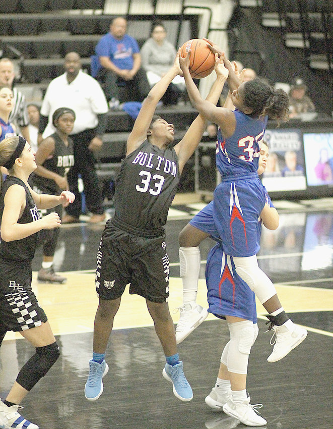 CLEVELAND LADY RAIDERS' Damaya Walker battles for a rebound against Bolton during the East/West Classic Saturday, at Bradley Central High School.