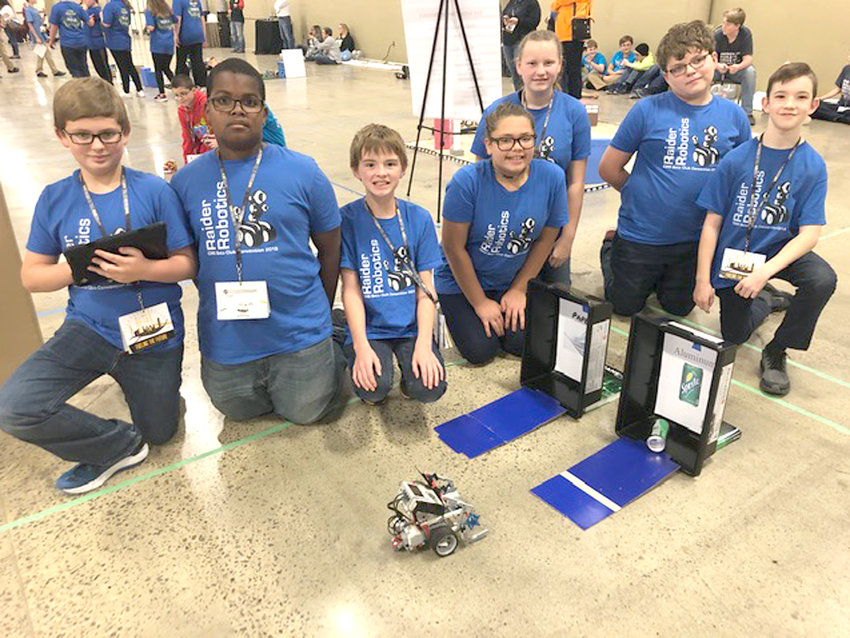 At left, the CMS Robotics Team (Erin Stancil, Kaylee Garcia, Adam West, Josiah Creel, Zionjah Jarrett, Will Mathews and Sean Williams) finished fifth overall in their category. Above, CMS Junior Beta Club attendees gather for a festive photo in Nashville.