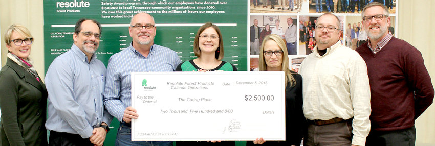THE CARING PLACE was presented with a $2,500 donation by Resolute Forest Products Calhoun Operations. From left are Resolute representatives Lynne Willett, Robert Sherwood and Scott Palmer; and The Caring Place Executive Director Corinne Freeman, with administrative assistant Julie Landberg and board members Tom Harris and Steve Smartt.