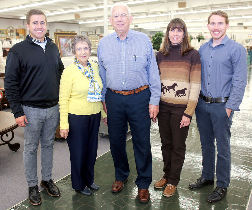OWNER BOBBY SCOTT, center, stands surrounded by his family and co-workers inside the family-owned Scott's Furniture. From left are Hunter Vest, grandson, Jeannine Scott, wife, Bobby Scott, Sandee Vest, daughter and Scott Vest, grandson.