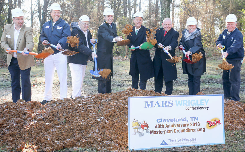 A LARGE DELEGATION of state and local officials – including Gov. Bill Haslam – met Tuesday at Mars Wrigley Confectionery in Cleveland, to celebrate the official groundbreaking ceremony for the new M&M Hazelnut Spread site. From left are Joe Burton, former site director; Mack Phillips, current site director; Rick Joines, 40-year Mars employee; Bob Rolfe, commissioner of the Tennessee Department of Economic and Community Development; Haslam; Mayor Kevin Brooks; Joanne Walker, former site director; and Todd Farell, former site director.