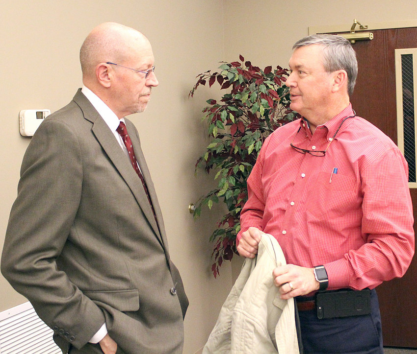 "KEITH BARRETT, right, speaks with Cleveland Bradley Chamber of Commerce VP of economic development Doug Berry, after a presentation Berry gave during a Chamber of Commerce ""Food for Thought"" luncheon Thursday. Berry reported interest is picking up among potential occupants for Spring Branch Industrial Park."