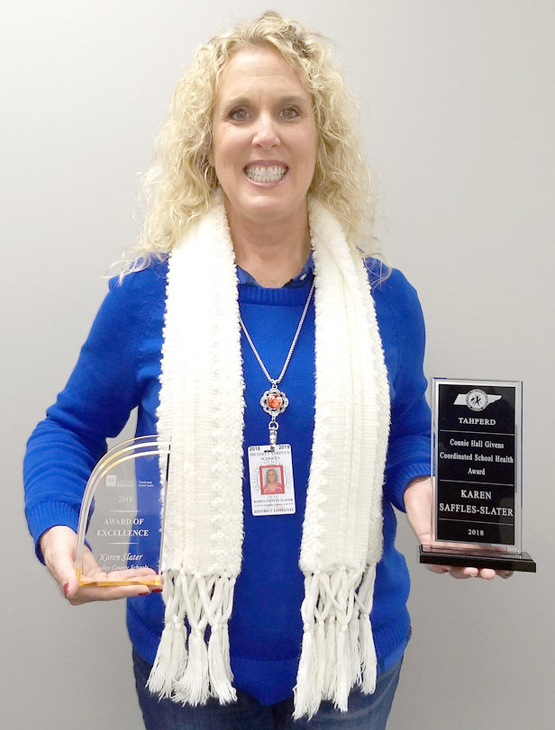 KAREN SAFFLES-SLATER, director of Coordinated School Health for Bradley County Schools, has this year been honored with awards from the Tennessee Department of Education and the Tennessee Association for Health, Physical Education, Recreation and Dance.