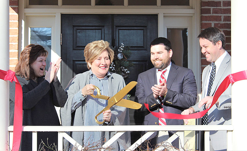 RECENTLY, A LOCAL law firm dedicated its office building for a late partner who passed away in 2013. At the dedication were, from left, Niki Sims, Kay S. Burns, Bryson M. Kirksey, and Travis D. Henry.