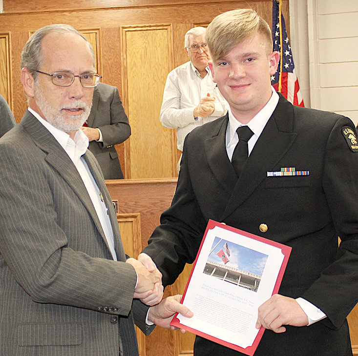 BRADLEY COUNTY Mayor D. Gary Davis, left, presents a certificate of appreciation to Sea Cadet Chief Petty Officer T.C. Jones for his service as Flag Sentry. In the background, partially obscured, are Commissioners Louie Alford and Thomas Crye.