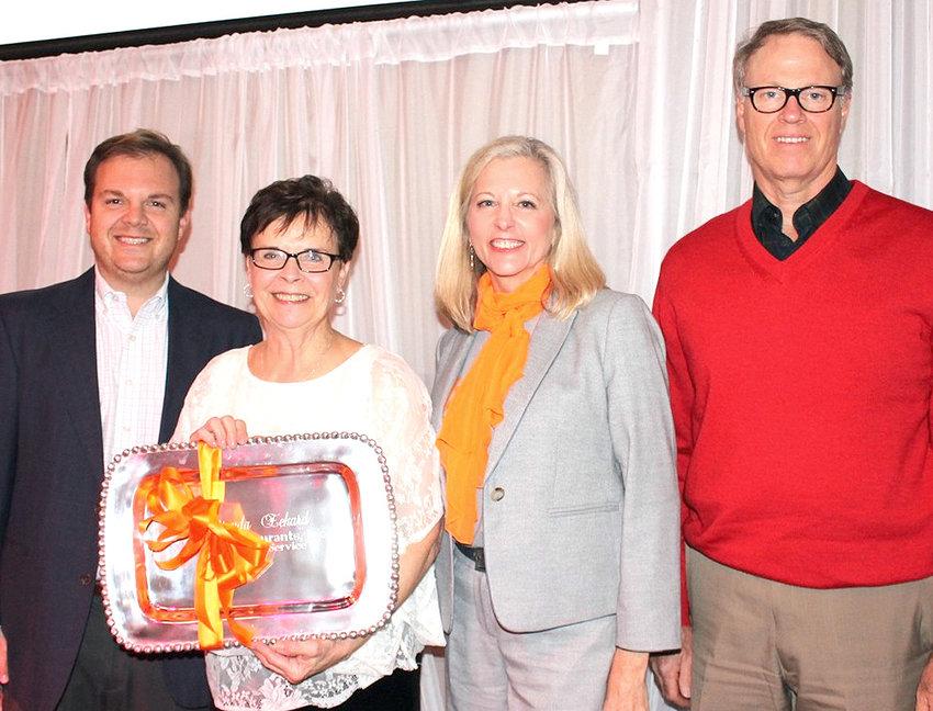 BRENDA ECKARD was presented a 40-year service platter during the J&S Restaurant Awards. From left are Steve Hartline, Eckard, President/COO Julia Scoggins and CEO Mark Johnson.