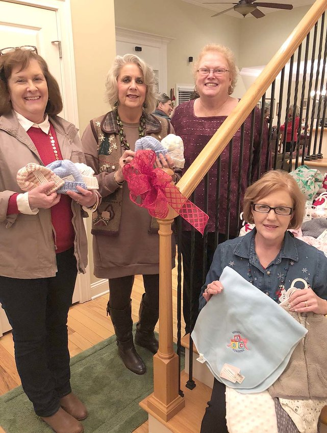 THE LADIES of the Alpha Theta Chapter of Alpha Delta Kappa recently held a Christmas party themed with its altruistic project for the month surrounding Tennova's newborn nursery unit. From left are Donna Spain, Walker Valley High School; Kim Covington, Ocoee Middle School; and Janet Blackwell and Melinda Braunstein, both of whom are retired.
