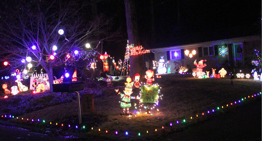 ONE OF the joys of the holidays is the lights and exterior décor of some of the homes in the community. Since photos of lights are difficult to take, it is hoped you will allow us a few slightly out-of-focus examples. The photo above is synchronized with radio station 94.9 FM. This light fest is located on Peerless Drive, just off Peerless Road and across from M&M Mars. The whole neighborhood has joined the fun with several homes adjacent to the synchronized display also festively decorated.