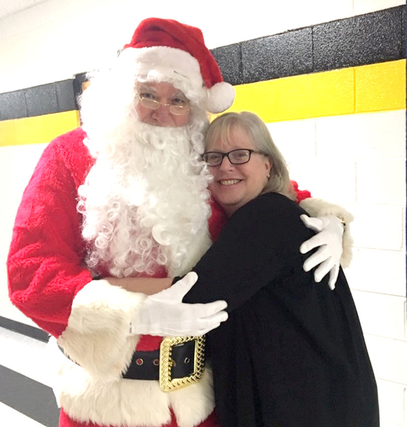 Santa visits with Mrs. Robin McChensey at the recent Hopewell Country Christmas.