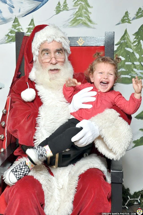 IT'S HARD TO tell which person in this photo is more traumatized. It's a reminder that Santa has seen things — some things he wishes he could unsee.